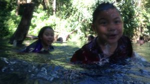 Children playing in the Sai Ngam hot spring